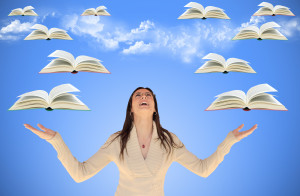 author with books flying around her