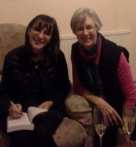Kathy Joyce signing a book