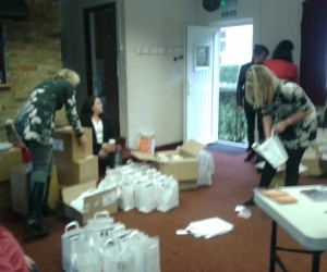 Photo of Triskele authors packing goody bags