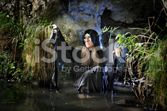 photo of a hag in a swamp outside a cave