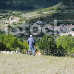 stock-photo-21623995-shepherd-and-flock-above-french-village