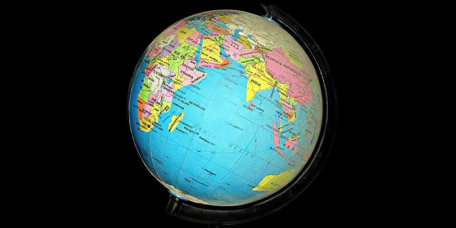 Photo Of A Globe Against A Black Background