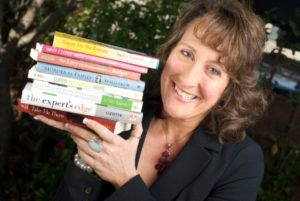 Headshot of Penny C Sansevieri with some of her books