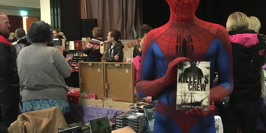 Spiderman Holding One Of Wendy Jones's Books