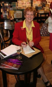 Photo of Alison at a book signing