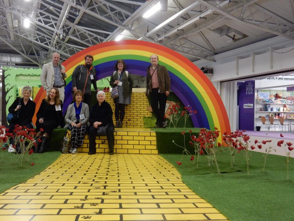 Yellow brick road and rainbow set with group of authors