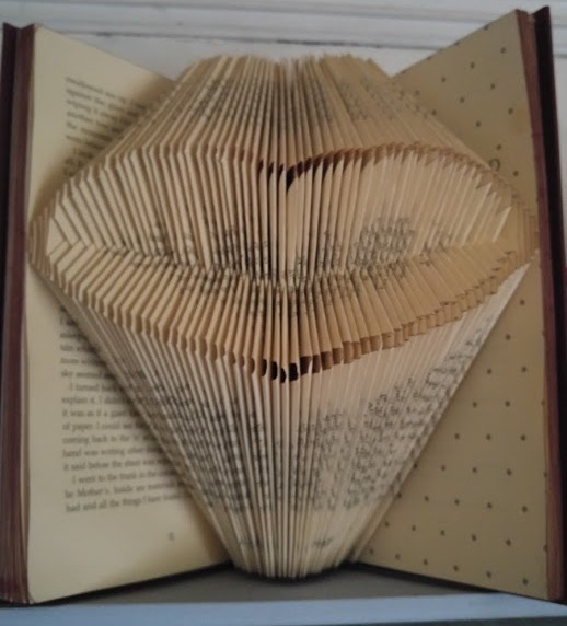 Photo of book folded into a heart shape