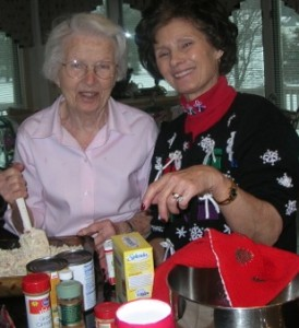 Elaine Pereira and her mother baking together