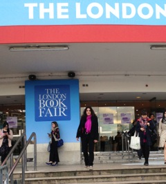 Photo of Maria on the steps of the London Book Fair's venue, Olympia