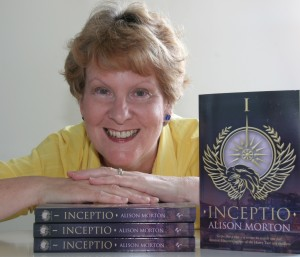 Headshot of Alison Morton with copies of Inceptio
