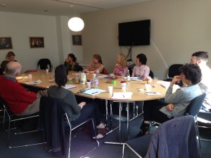 Photo of writers and mentors in a meeting room