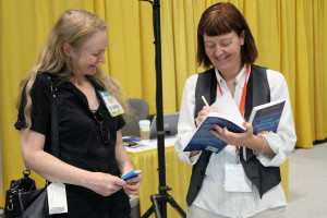Orna Ross (r.) signing books in The Author Hub