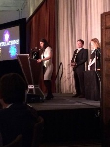 Photo of Rebecca on stage at the awards ceremony