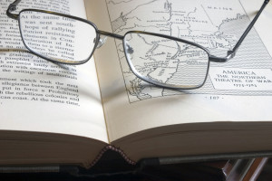 Pair of glasses on an open book