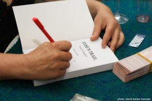 Hand signing a book