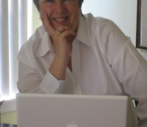 Photo of Jane Steen at her computer