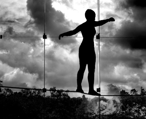 Image Of A Tightrope Walker Carefully Balancing On A High Wire
