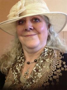Helen Hollick wearing a cream hat