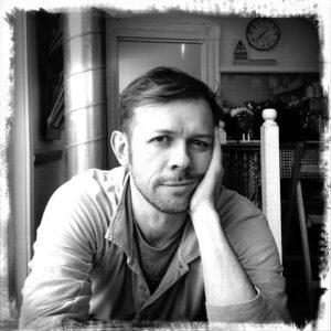 head and shoulders photo of Piers Alexander