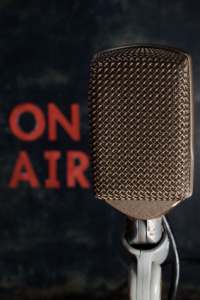 "microphone with caption saying ""On Air"""