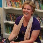 Photo of Alison Morton signing books