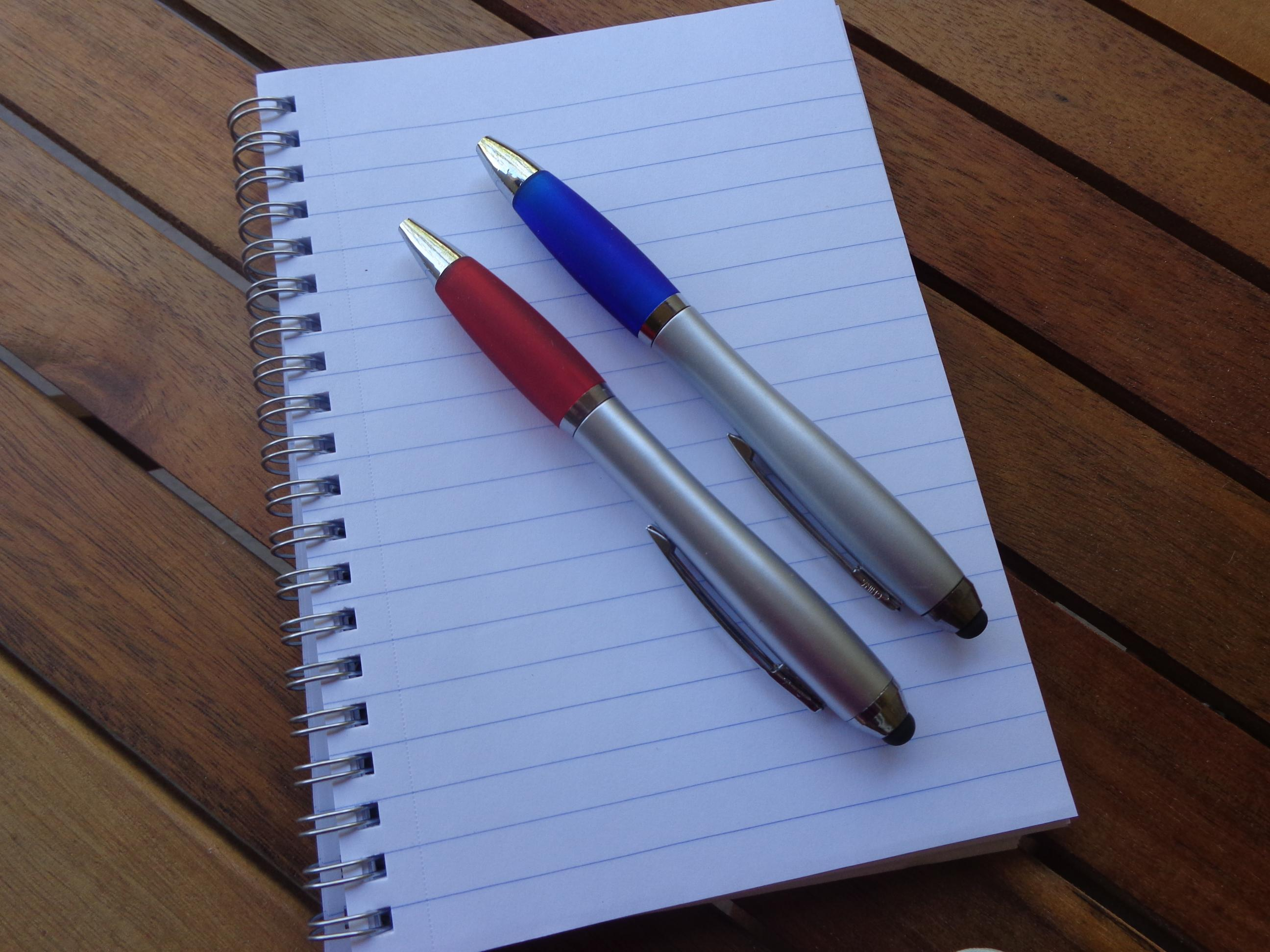 Image Of Two Pens Lying Side By Side