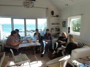 Writers in the lounge of the flat, with sea view