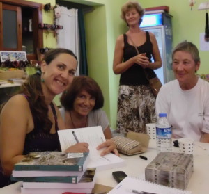 Atulya Bingham signing books for readers