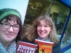 Debbie Young and Julia Forster holding books outside a shop