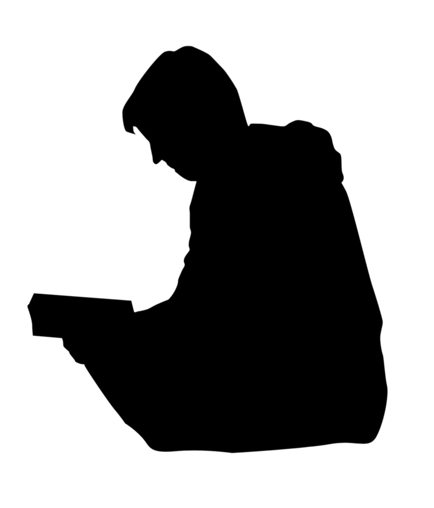 SIlhouette of a man reading a book