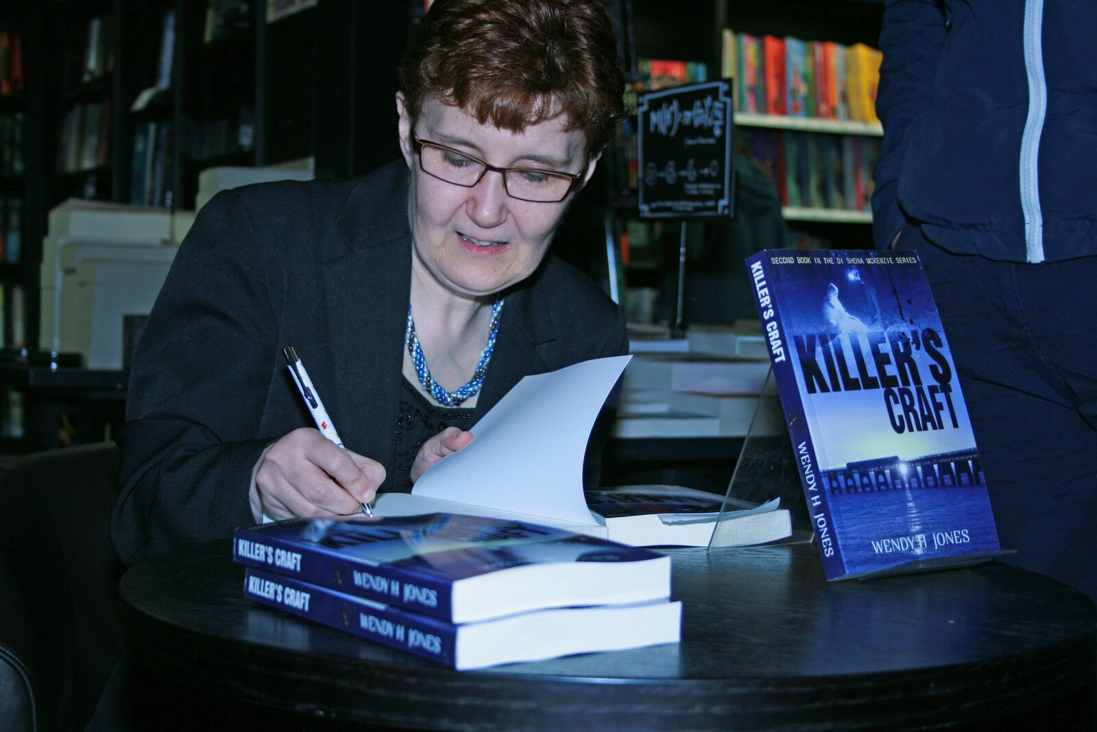 Photo Of Wendy H Jones Signing Books