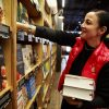 Mika Yamamoto, director of marketing for Amazon Books, works inside of Amazon Books in Seattle Monday, Nov. 2, 2015. Amazon Books, the company's first brick-and-mortar store, will open tomorrow Tuesday, Nov. 3, 2015 in Seattle's University District.