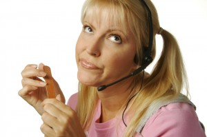 Bored customer service lady in headphones filing nails