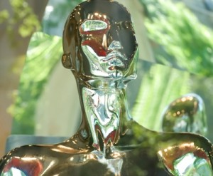 Photo of golden figure of an androgynous person