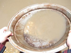 photo of a goldpanning pan with gold stars in it