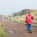 stock-photo-14436757-active-senior-hiking-on-the-moors