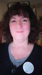 Photo of Debbie wearing Hawkesbury Upton Lit Fest badge