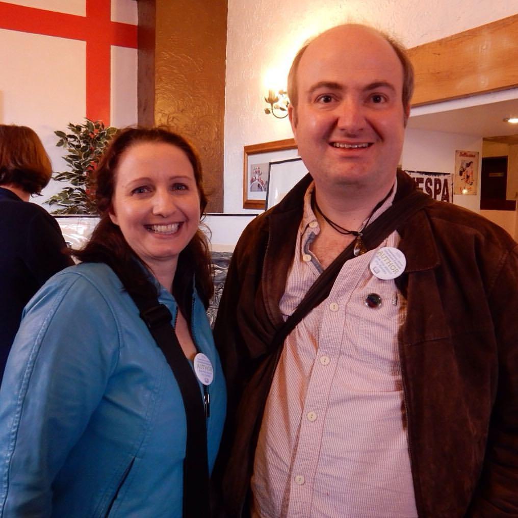 photo of Joanna Penn and Thomas Shepherd wearing author badges