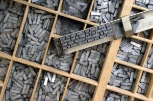 metal letters in printers tray