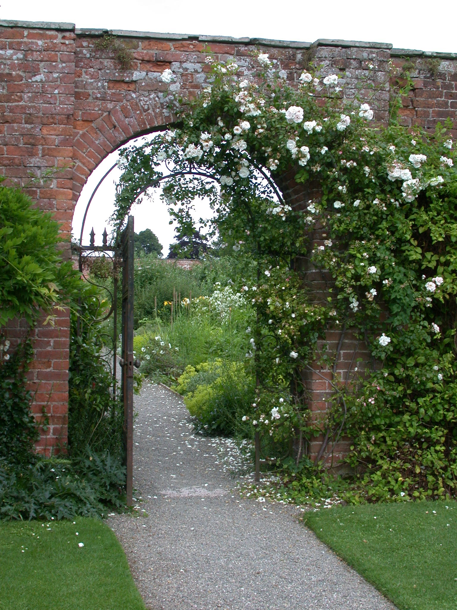 Photo Of Gate Opening Into A Beautiful Garden
