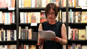 Photo of Jane Davis reading from her book