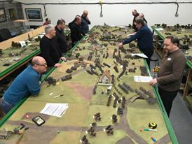 group of middle-aged men playing wargames