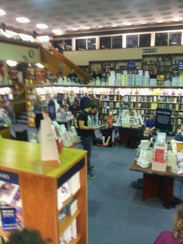 Photo of Joe reading before an audience in Blackwell's bookshop