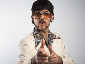 sleazy pick-up artist in 70s leisure suit