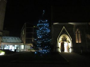 straddling the old and new, digital and physical, Oxford Christmas tree between historic St Luke's Chapel and the brand new Maths Institute