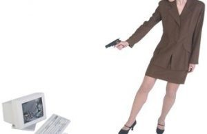 Image of woman turning a gun on a PC