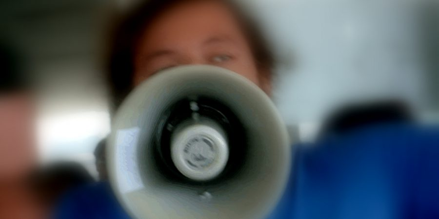 Photo Of A Person Shouting Through A Megaphone
