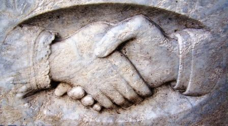 Stone Carving Of A Handshake