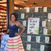 Author outside bookshop window