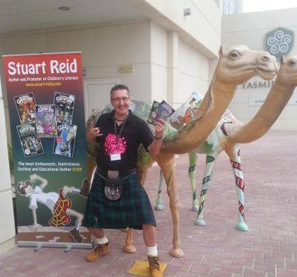 Photo of Stuart in Dubai outside one of his events